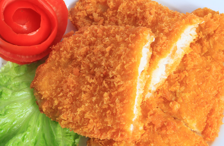Crispy breaded pangasius portions
